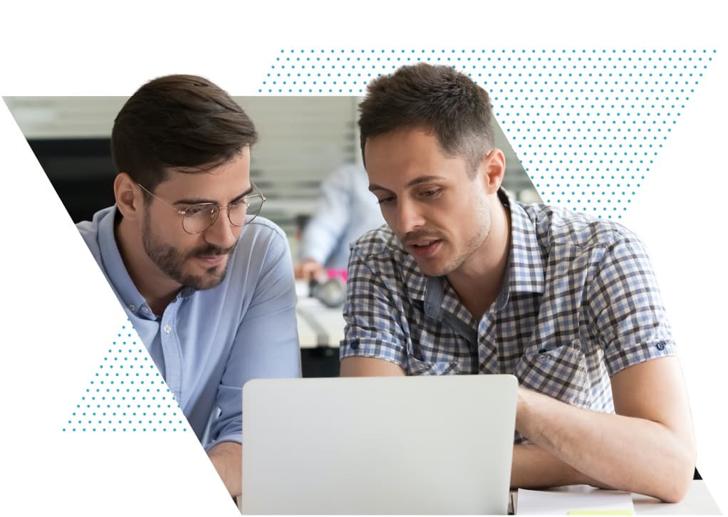 two-developers-looking-at-laptop@2x